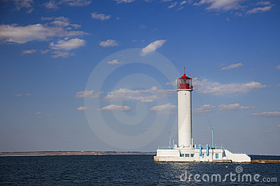 White lighthouse against the blue sky