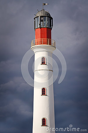 White lighthouse over dramatic sky