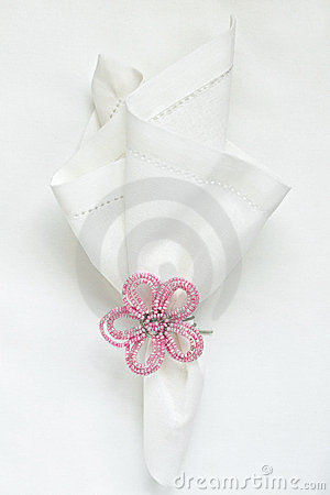 White linen napkin with beaded napkin ring
