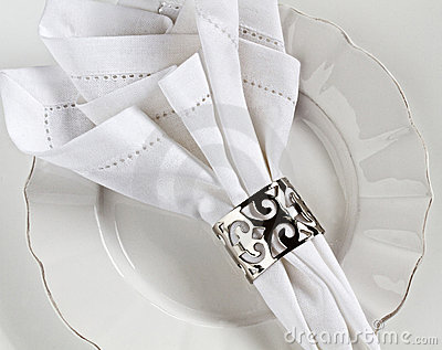 White linen table place setting