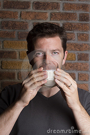 White male drinking glass of milk