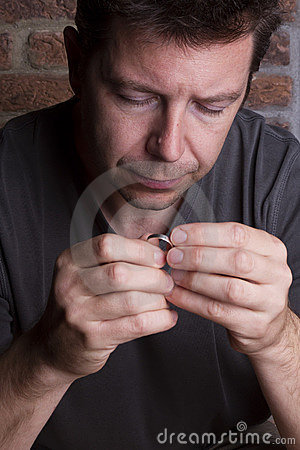 White Male Focussing on Ring in Hand