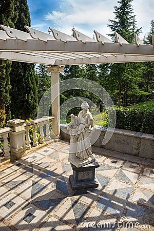 White marble garden sculpture in antique greek Stock Photo