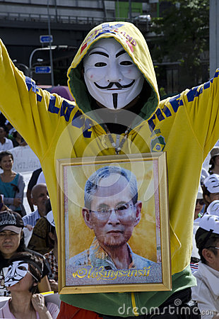 White-Mask protestor with portrait of King Editorial Image