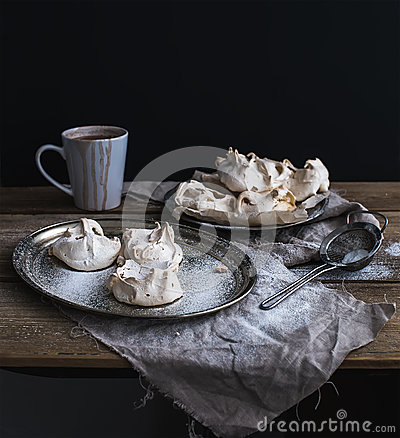 Free White Meringue And Mug Of Hot Chocolate On A Rustic Wooden Table. Black Backdro Stock Photography - 50758202