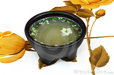 White Miso soup on floral tablecloth