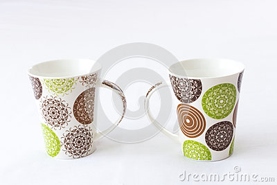 White mugs with colored design