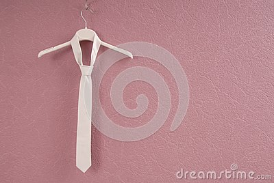A white necktie is on hanger.