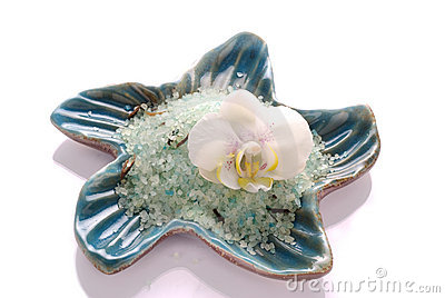 White orchid flower with blue mineral bath salt