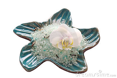 White orchid flower with mineral bath salt