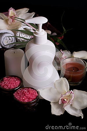 White orchids and spa treatment products