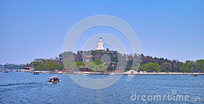 White pagoda and boat in the lake of the North Sea Editorial Photography