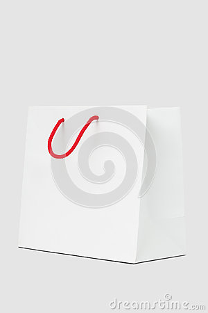 White paper bag with red string handle