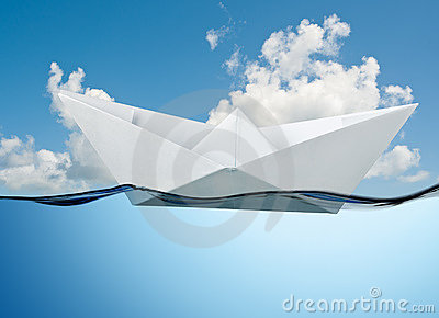 White paper boat floating.