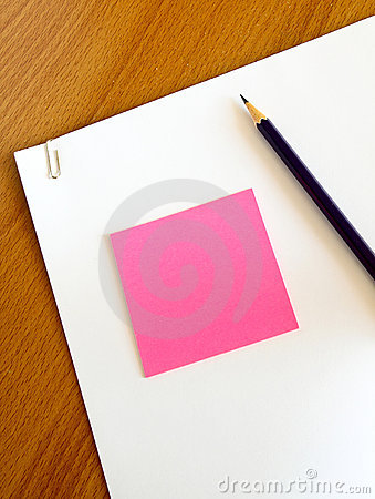 White paper with pencil and memo on table