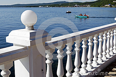 White parapet, the Angara River, motorboat