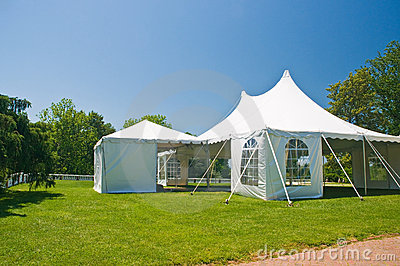 White party or event tent on lawn