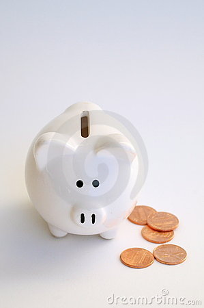 White piggy bank and new pennies