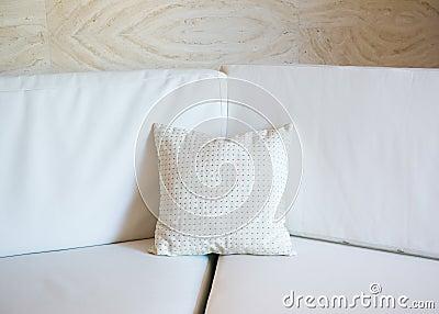 White pillow on a sofa