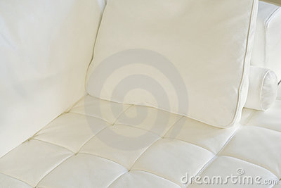 White Pillow on a White Sofa