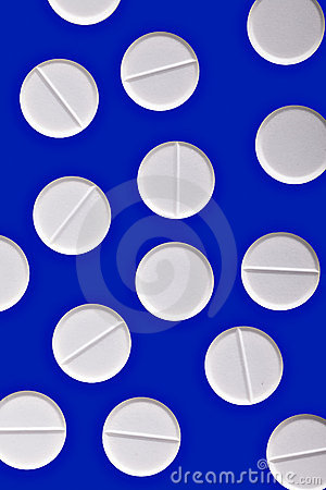 White pills on blue medicine cure background