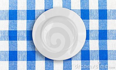 White plate on checked fabric tablecloth