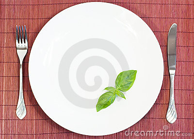 White plate with fork and knife