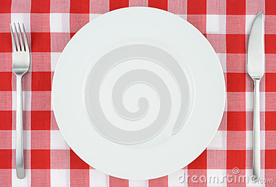 White plate on red and white checkered cloth