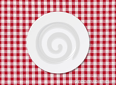 White plate on tablecloth