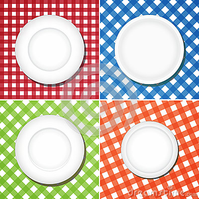 White plates on checkered tablecloth