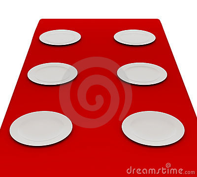 White plates on a red cloth.