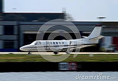 White private corporate jet taking off