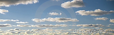 White puffy clouds and blue sky