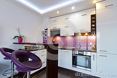 White and purple kitchen with spotlights