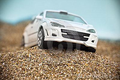 White racing toy car on rough terrain