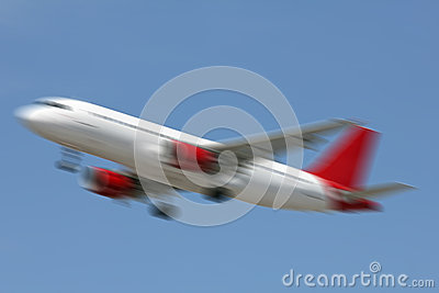 White and red plane landing