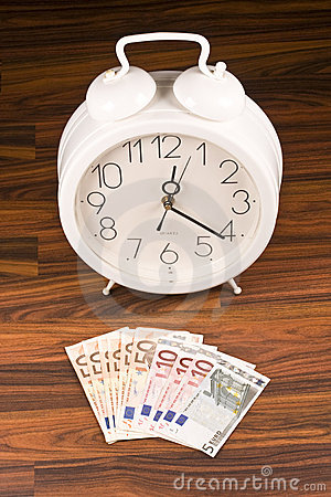 White retro alarm clock and money