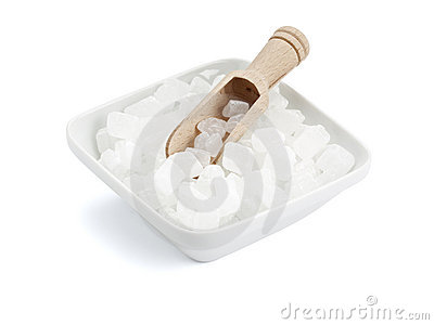 White rock candy in square bowl with wooden shovel