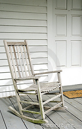 Antique White Rocking Chair on Porch