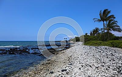 White rocks cover beach at Waiulua Bay Hawaii