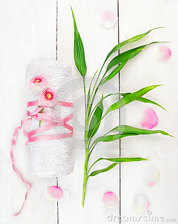 Free White Rolled Up Towel With Pink Flowers And Bamboo Shoots Stock Photo - 39414160
