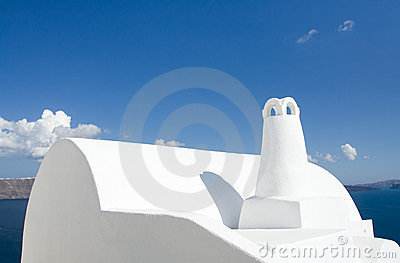 White roof, chimney Oia Santorini island Greece