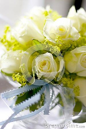 White roses in mason jar
