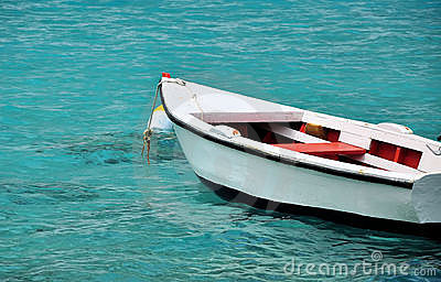 White row boat in clear blue water