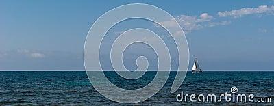 White sailboat on the horizon