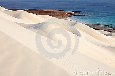 White sand dunes and sea