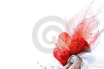 White satin cloth with two red hearts