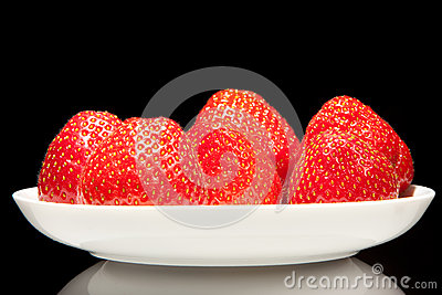 White saucer with red strawberry