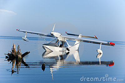 White seaplane reflection and blue lake