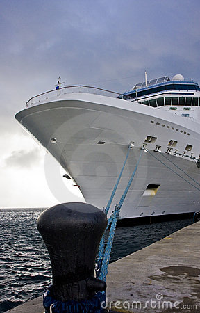 White Ship Tied to Black Bollard